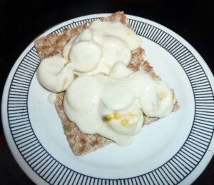 Ryvita Fruit Crunch Crispbread with banana, yoghurt, honey basil and passion fruit