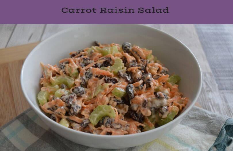 A bowl of carrot raisin salad