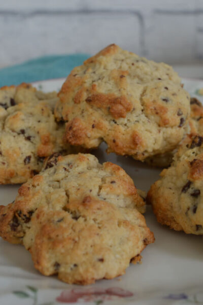 A flowery plate with five rock cakes on it