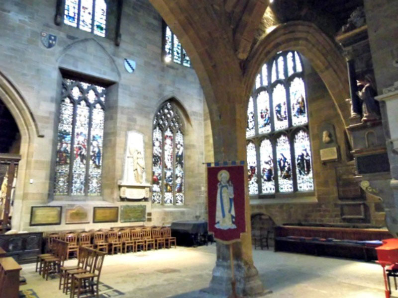 Some of the stained glass windows inside the cathedral church of St Nicholas