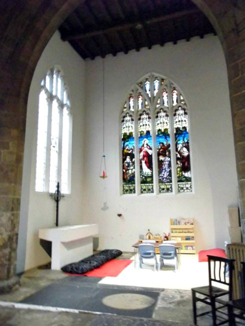 A cathedral side chapel with a kids reading corner
