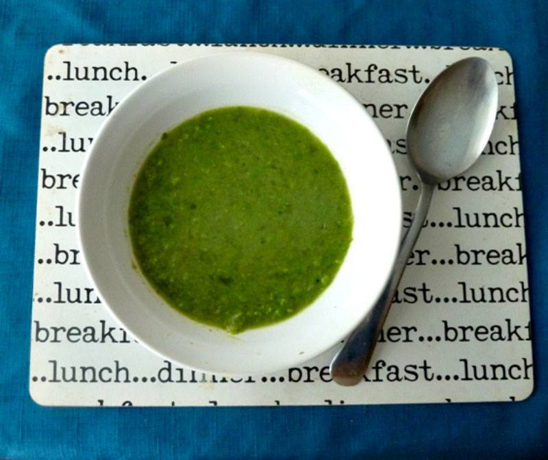 Pea and lettuce soup in a bowl on a table