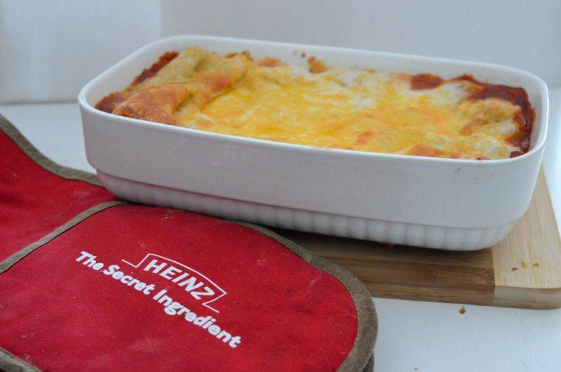 Baked bean lasagne in a dish on the table