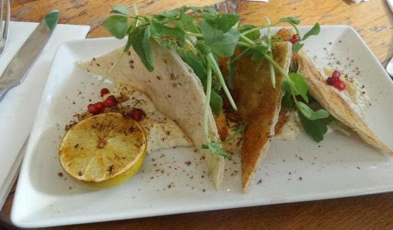 Breaded Halloumi with Hummus, Dukkah, House Flatbread & Pomegranate starter at Revolution Newcastle