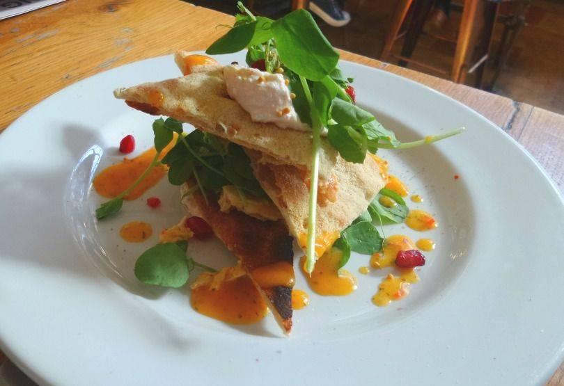 mango chicken & ricotta salad with homemade flatbread & pomegranate starter at revolution