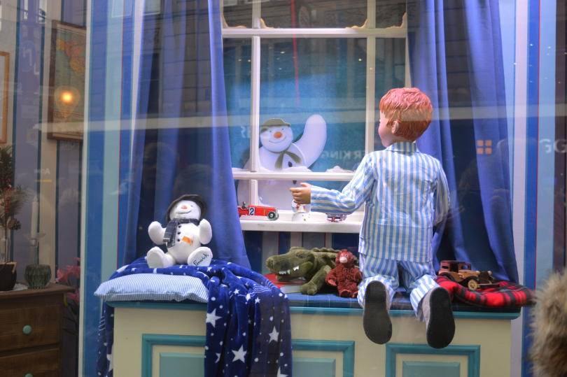 The snowman waving goodbye to James