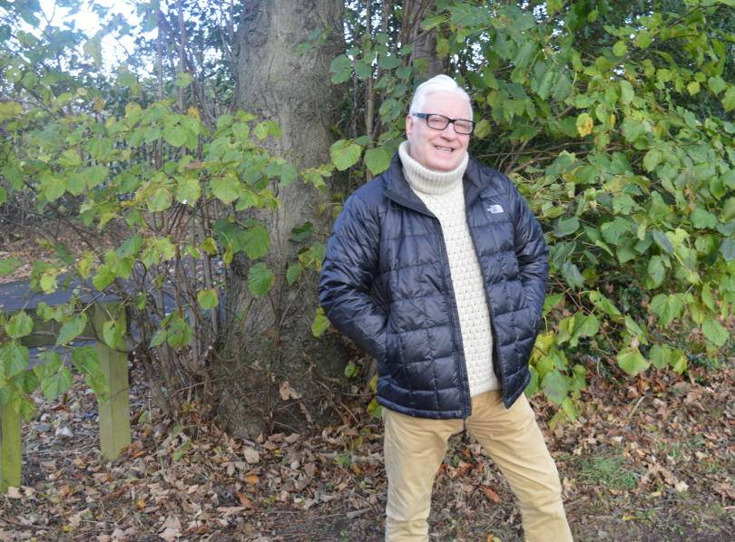 Man wearng North Face winter jacket under tree