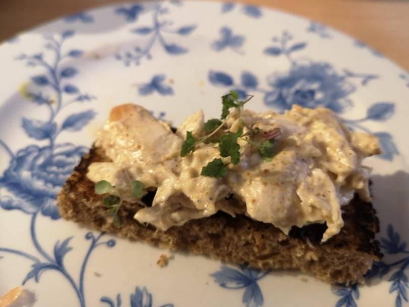 Coronation chicken open sandwich on a plate