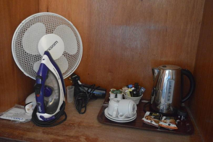 Tea and coffee faciitlies, iron and fan inside wardrobe at Beamish Hall hotel
