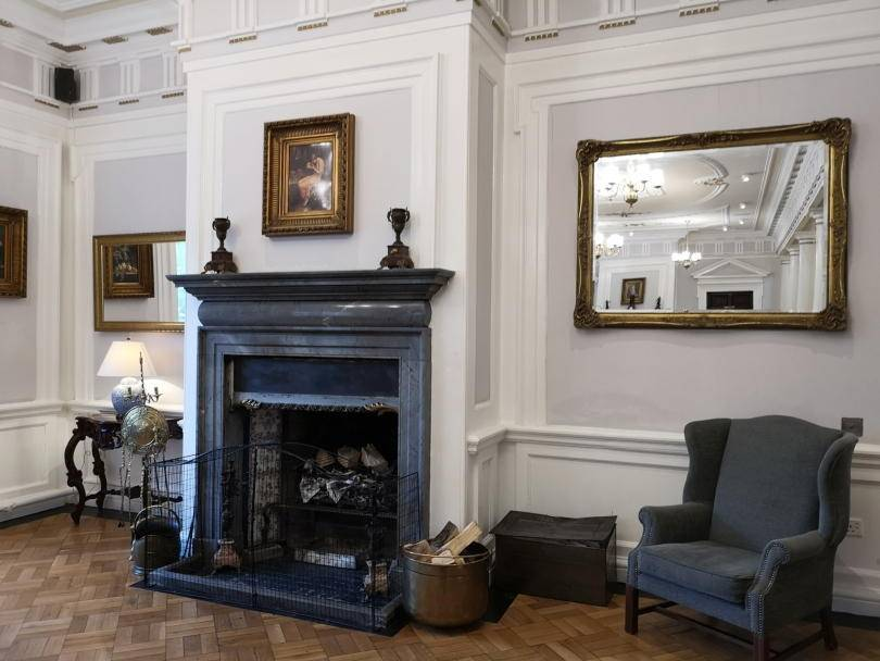 A fireplace and mirror in the entrance of Beamish Hall hotel
