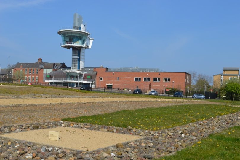 view across the excavated roman fort at Segedunum with the viewing tower in the background