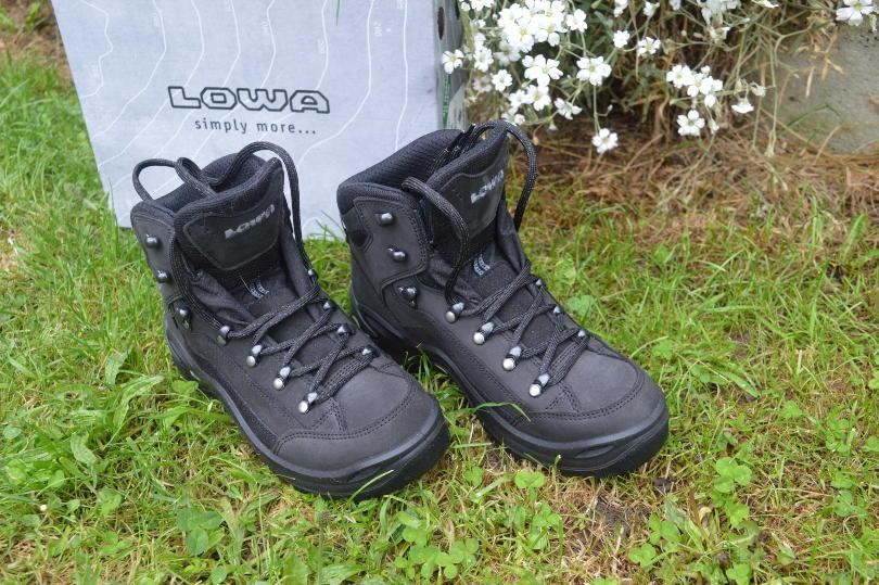 Lowa renegade hiking boots on grass beside box