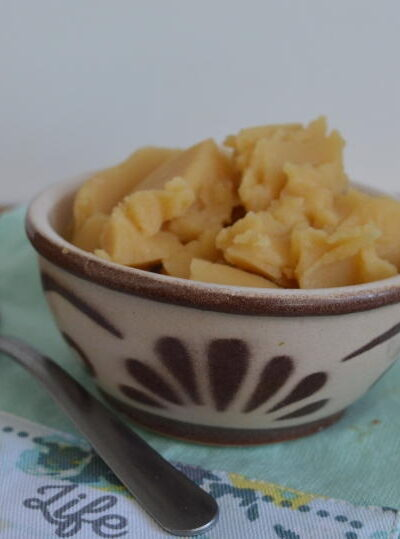 Pease pudding in a bowl on a green cloth