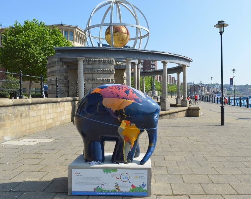 Elmer the elephant decorated with a world map