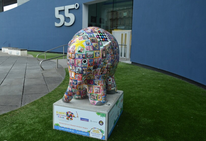 Elmer with portraits of people on in a patchwork design