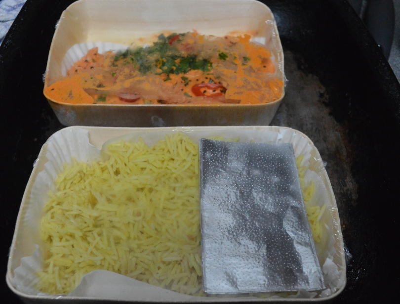 chicken tikka masala and pilau rice ready to cook on baking tray