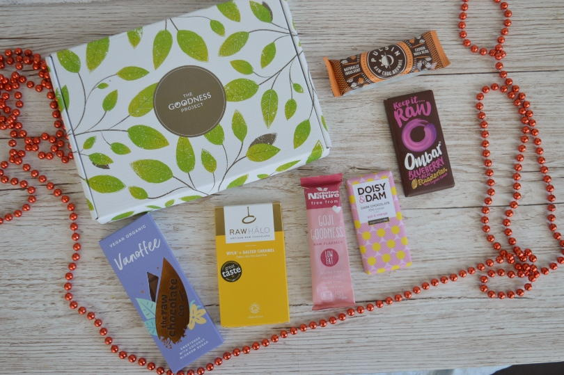 A mixed selection of chocolate bars beside a gift box