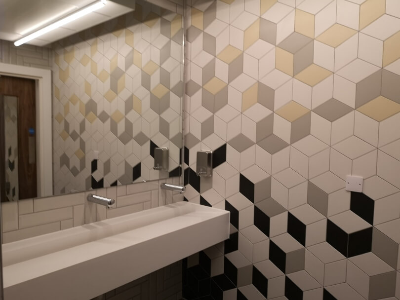 The gym changing rooms with tiled walls