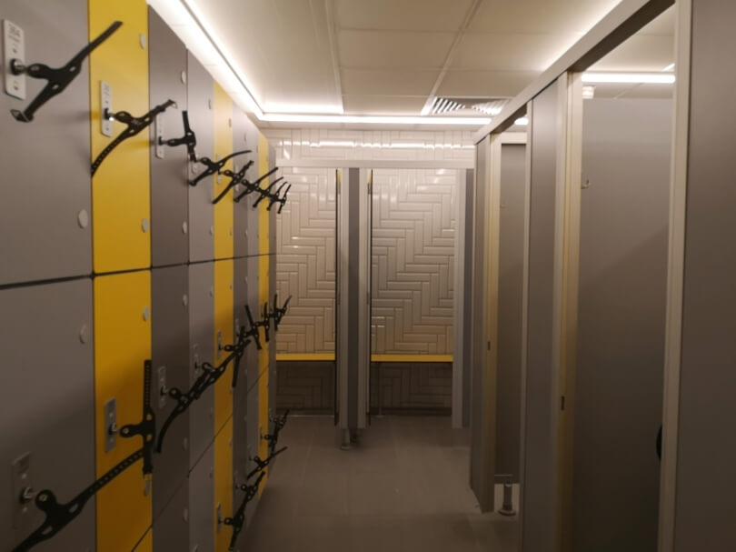 The poll changing rooms at Newcastle City Pool showing the yellow lockers and couple of cubicles