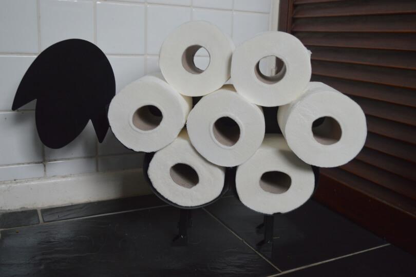 A toilet roll holder shaped like a sheep