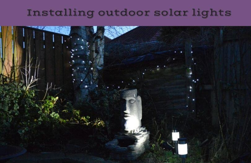 A garden with solar path lights and solar fairy lights set up