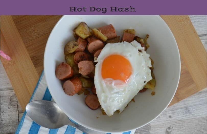 Hot dog hash in a bowl with an egg on top