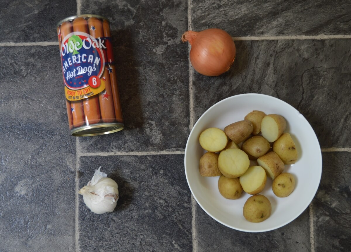 Tin of hot dogs, onion, garlic and cooked potatoes