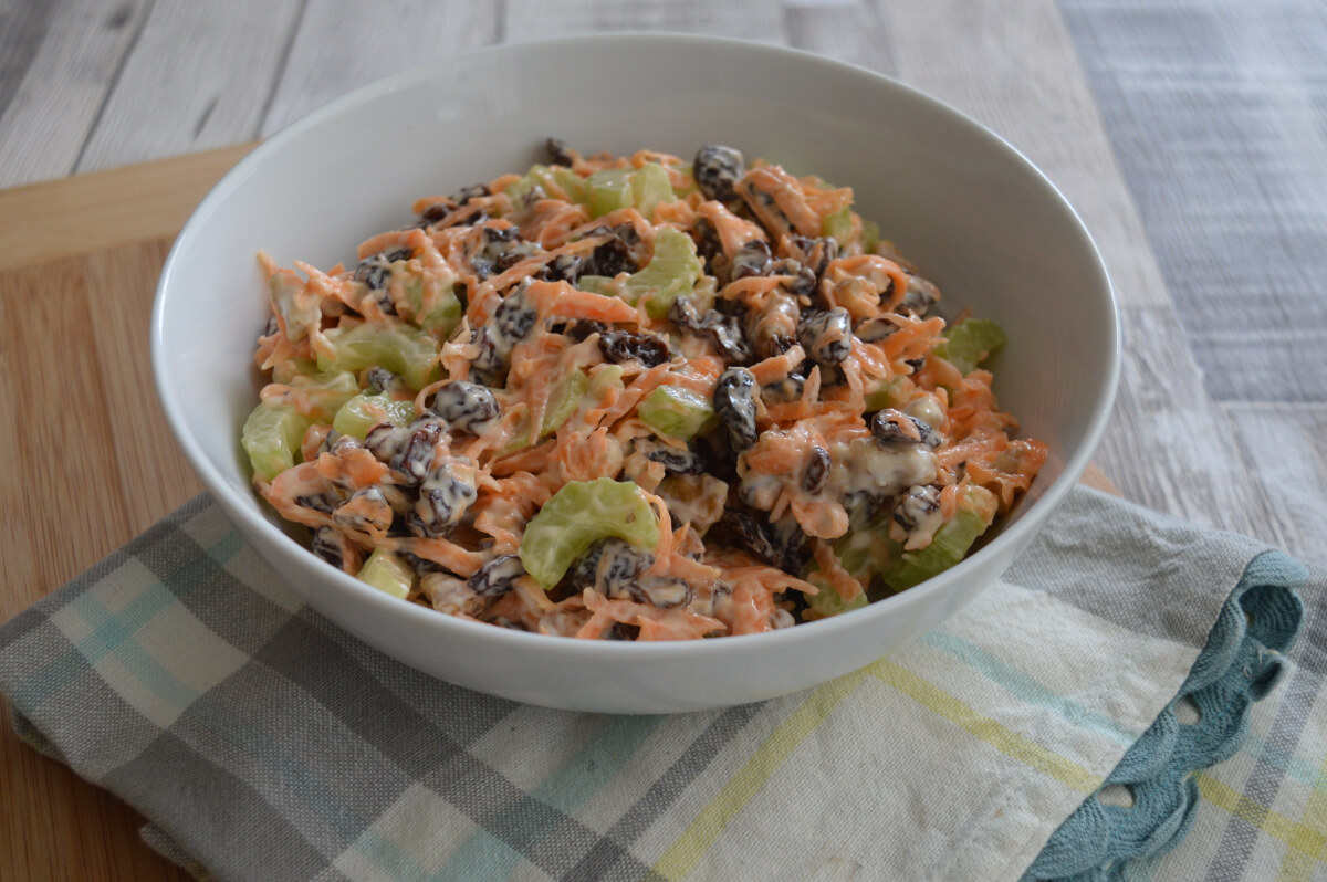 Salad with carrots, raisins, walnuts and celery in a bowl