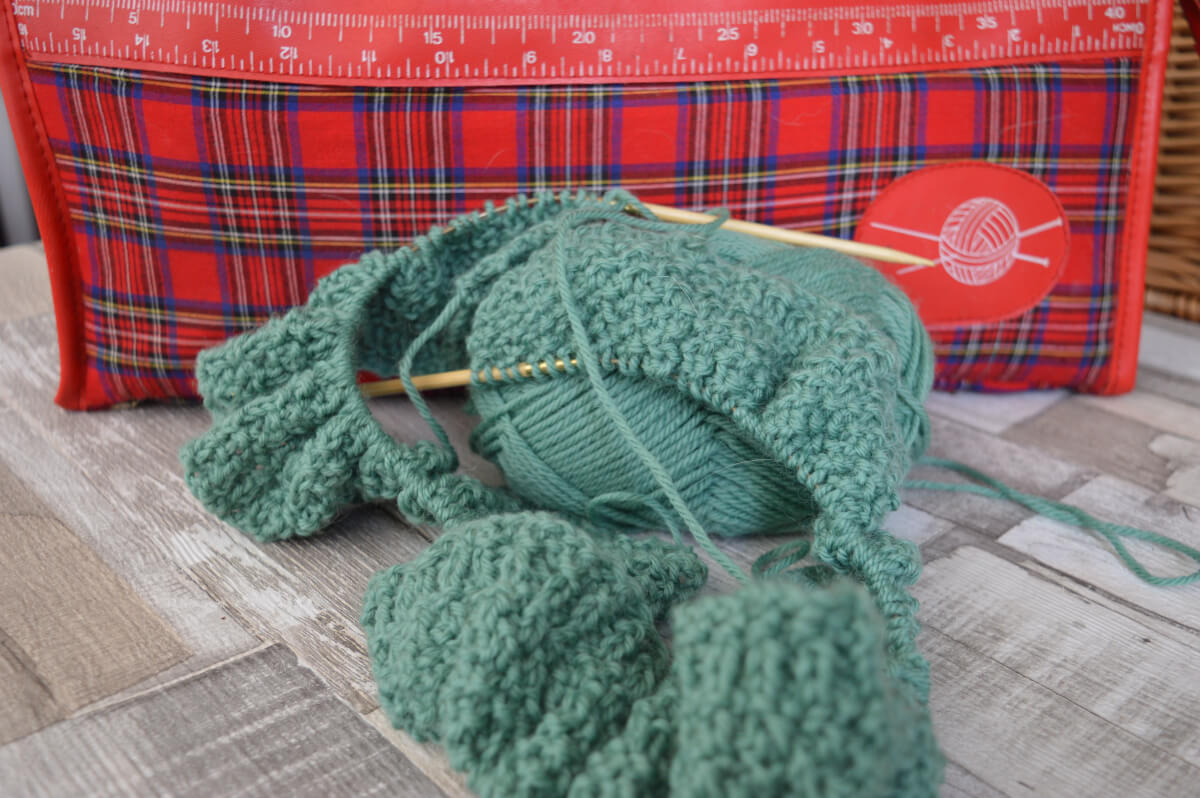 Knitting in front of a knitting bag