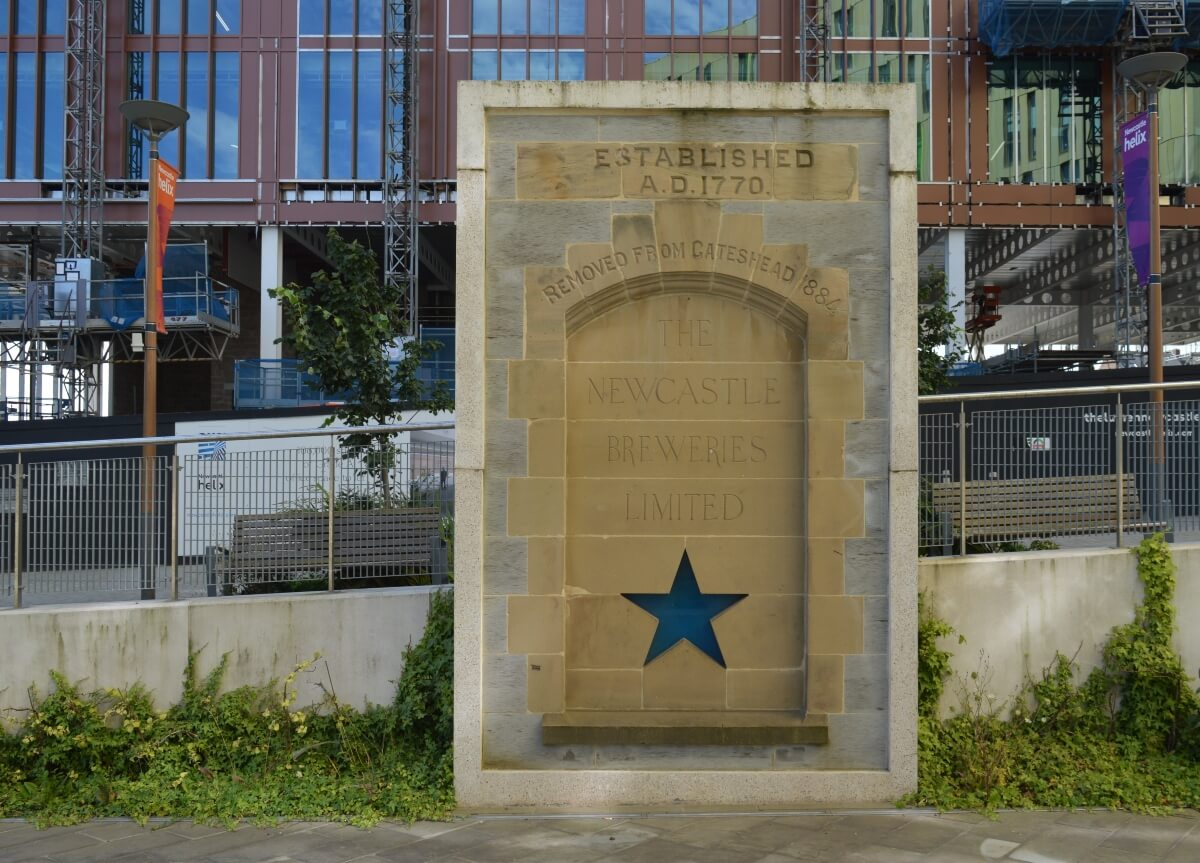 Monument with blue star marking the site of the former Newcastle breweries