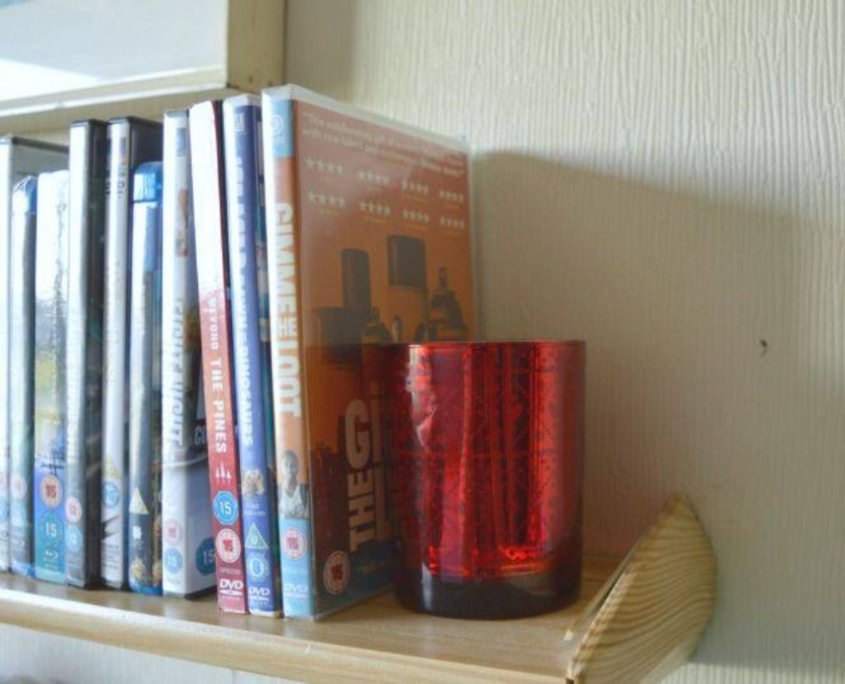 A scented candle on a shelf