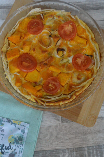 Pumpkin and onion quiche on a table