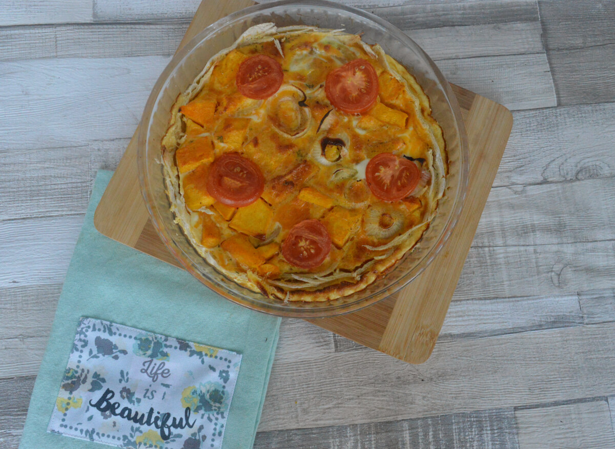 Pumpkin and onion quiche in a dish on the table