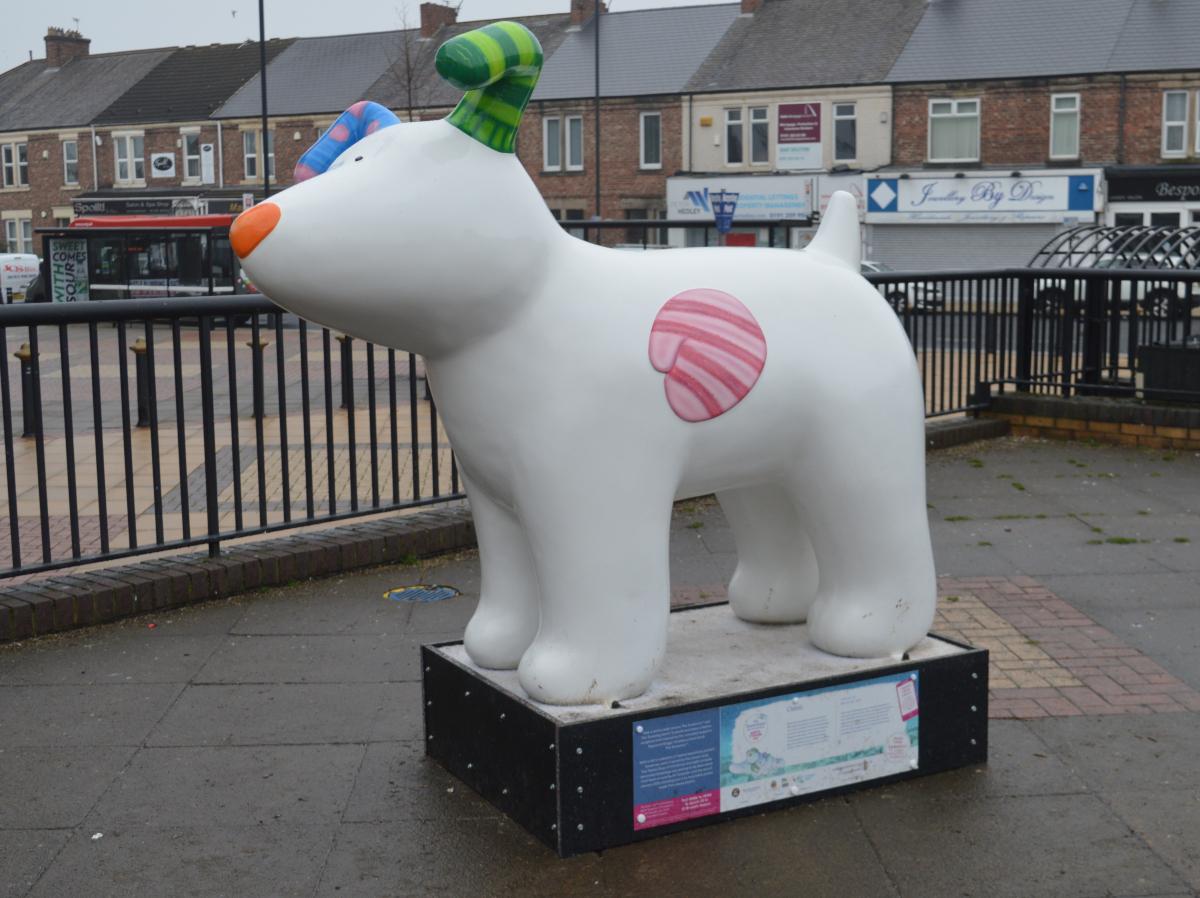 Classic snowdog statue