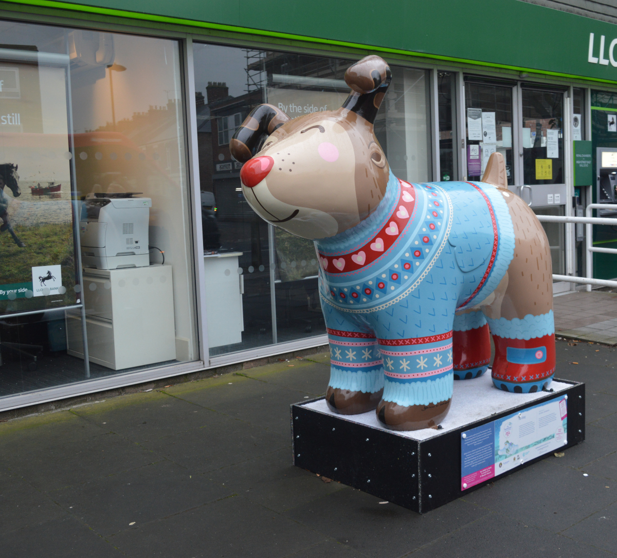 Snowdog statue - This is Ru dog with a red nose and colourful Christmas jumper