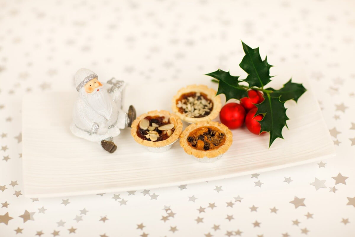 Mince pies and holly on a table