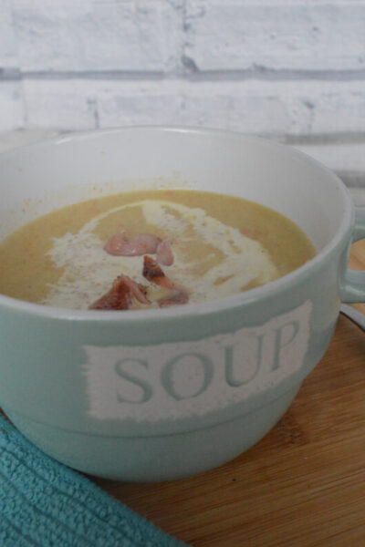 neep and tattie soup in a green bowl with soup written on the side