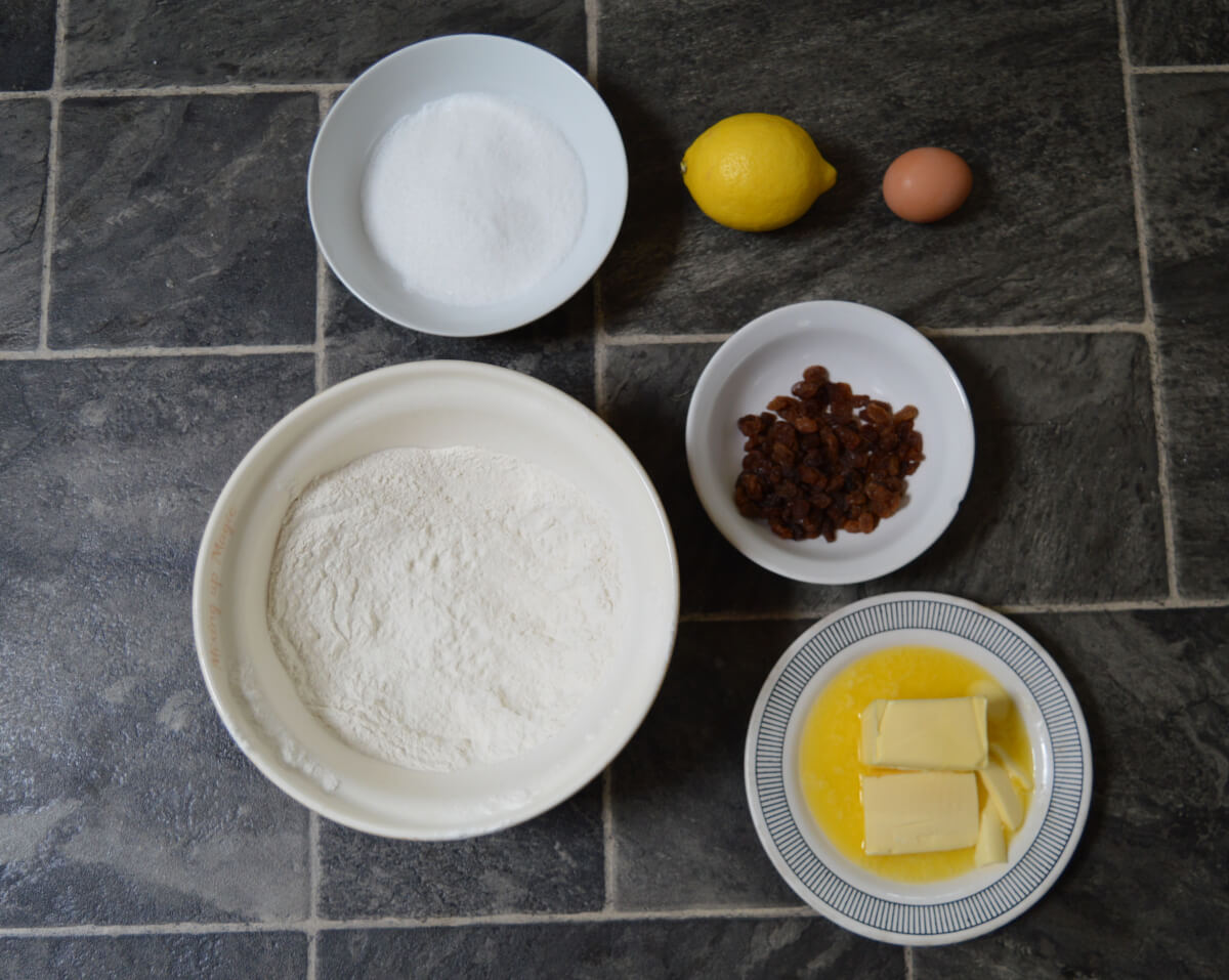 Biscuit ingredients in bowls on a tiled background