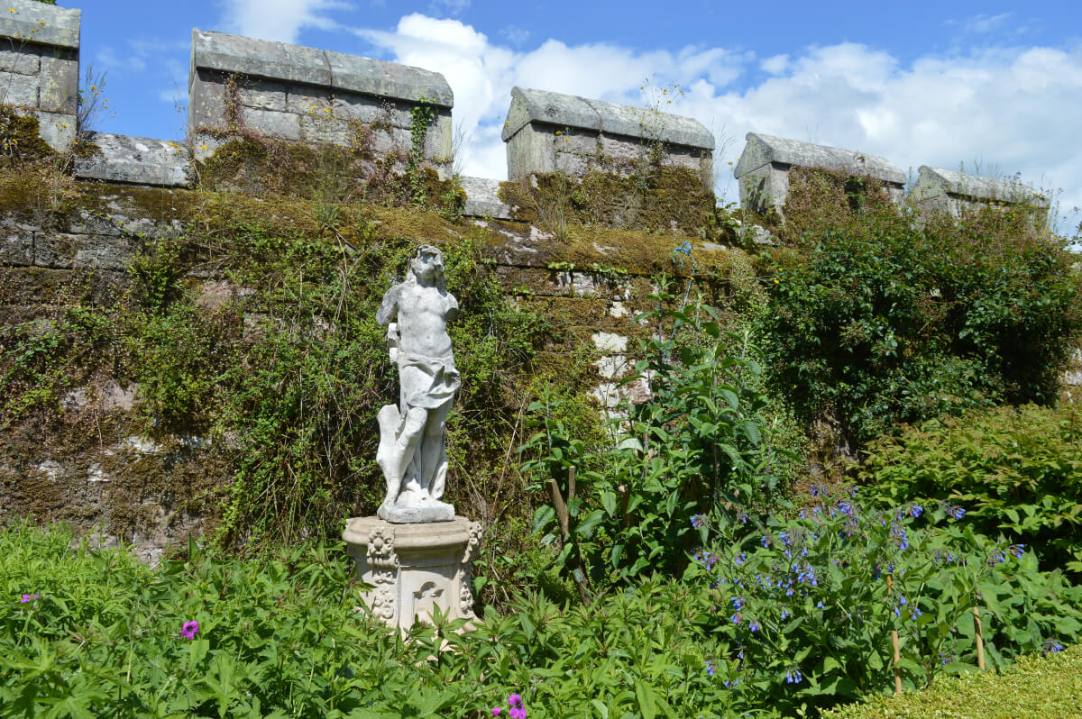A statue of man in the garden