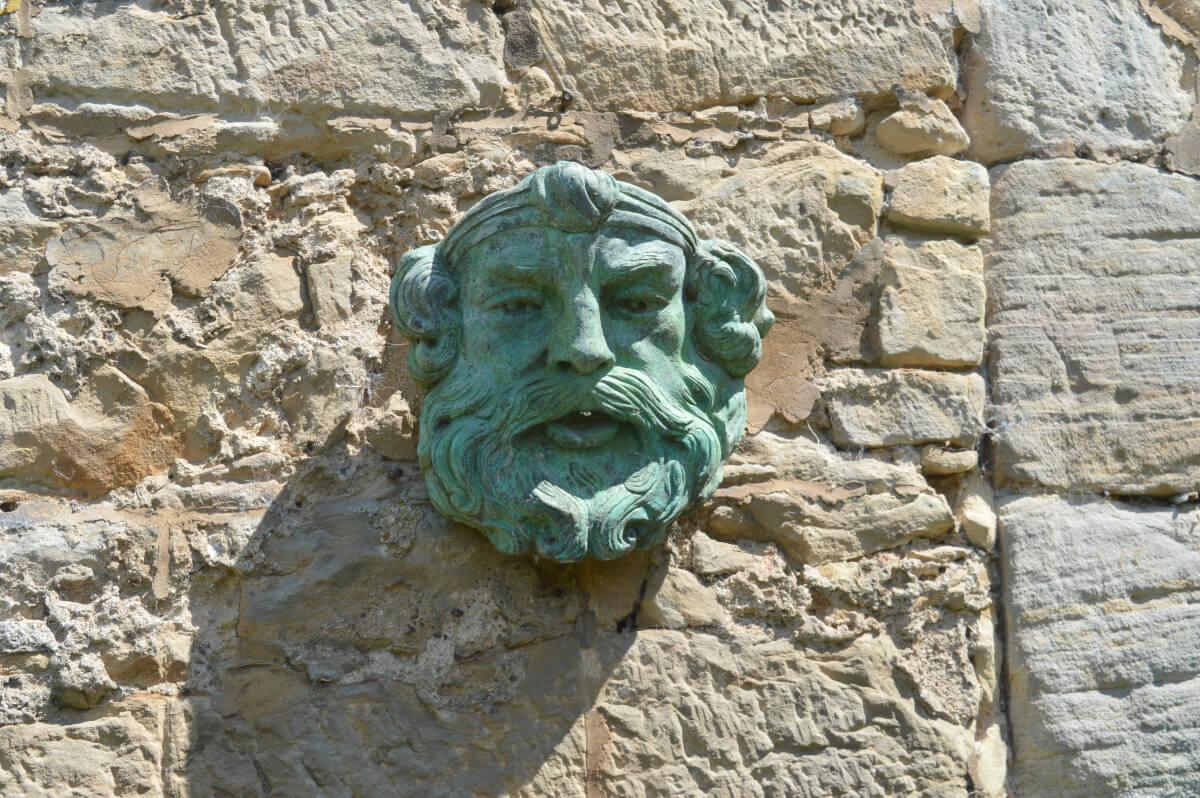 A green head on a wall