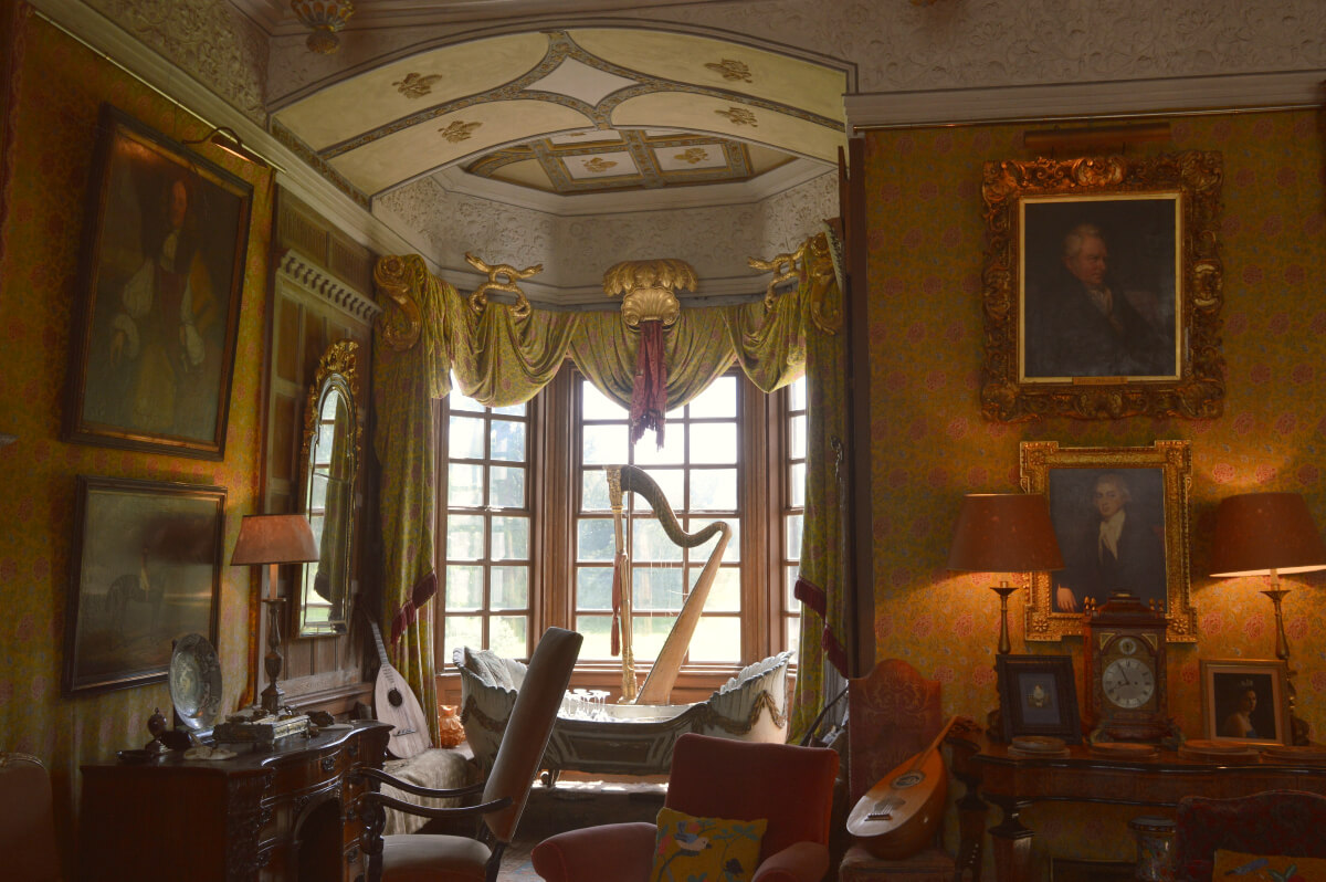 King James I room. A harp stands by the window and various lutes are places on seats